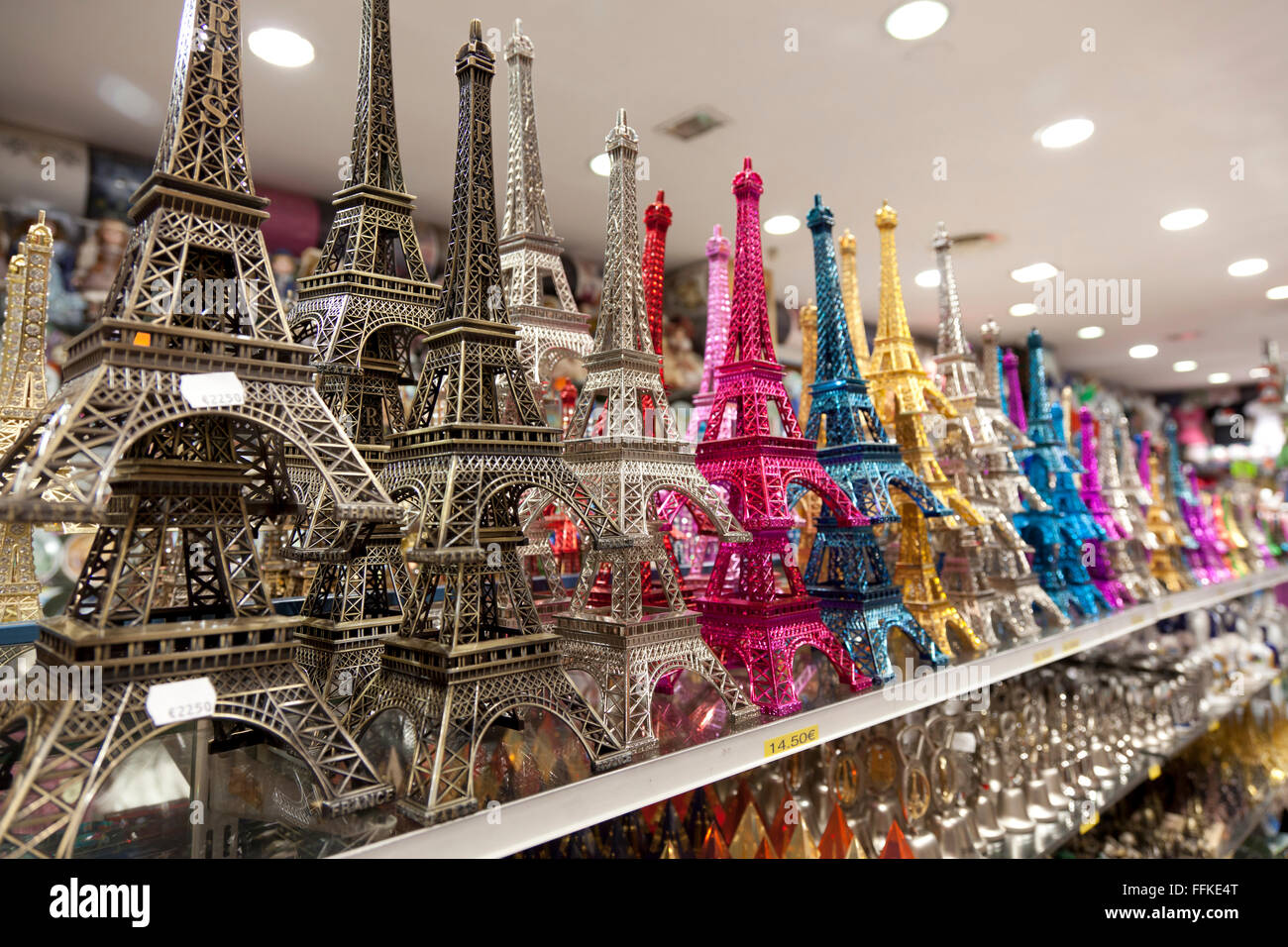 Small and colored miniature Eiffel tower souvenirs - Stock Image