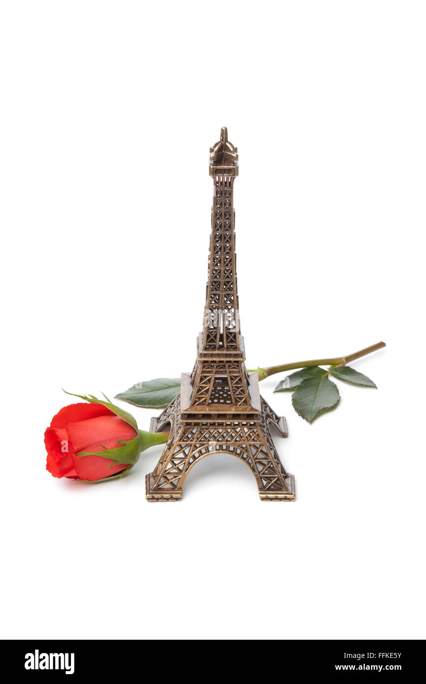 Eiffel tower souvenir with a red rose on white background - Stock Image