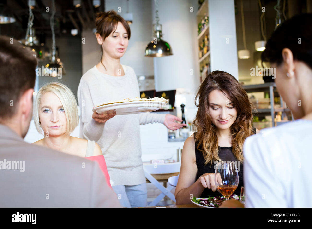 Group of friends celebrating in restaurant Stock Photo