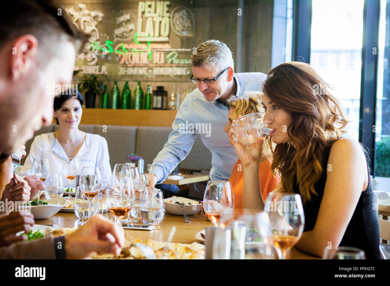 Group of friends on dinner party in restaurant - Stock Image
