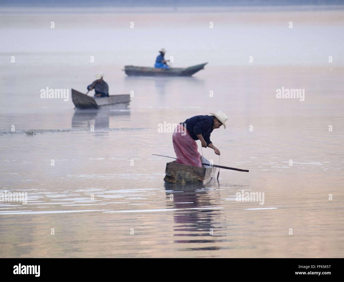 Feb. 17, 2013 - Santiago Atitlan, Solola, Guatemala - Fishermen at work on Lake Atitlan in Santiago Atitlan, Guatemala - Stock Image