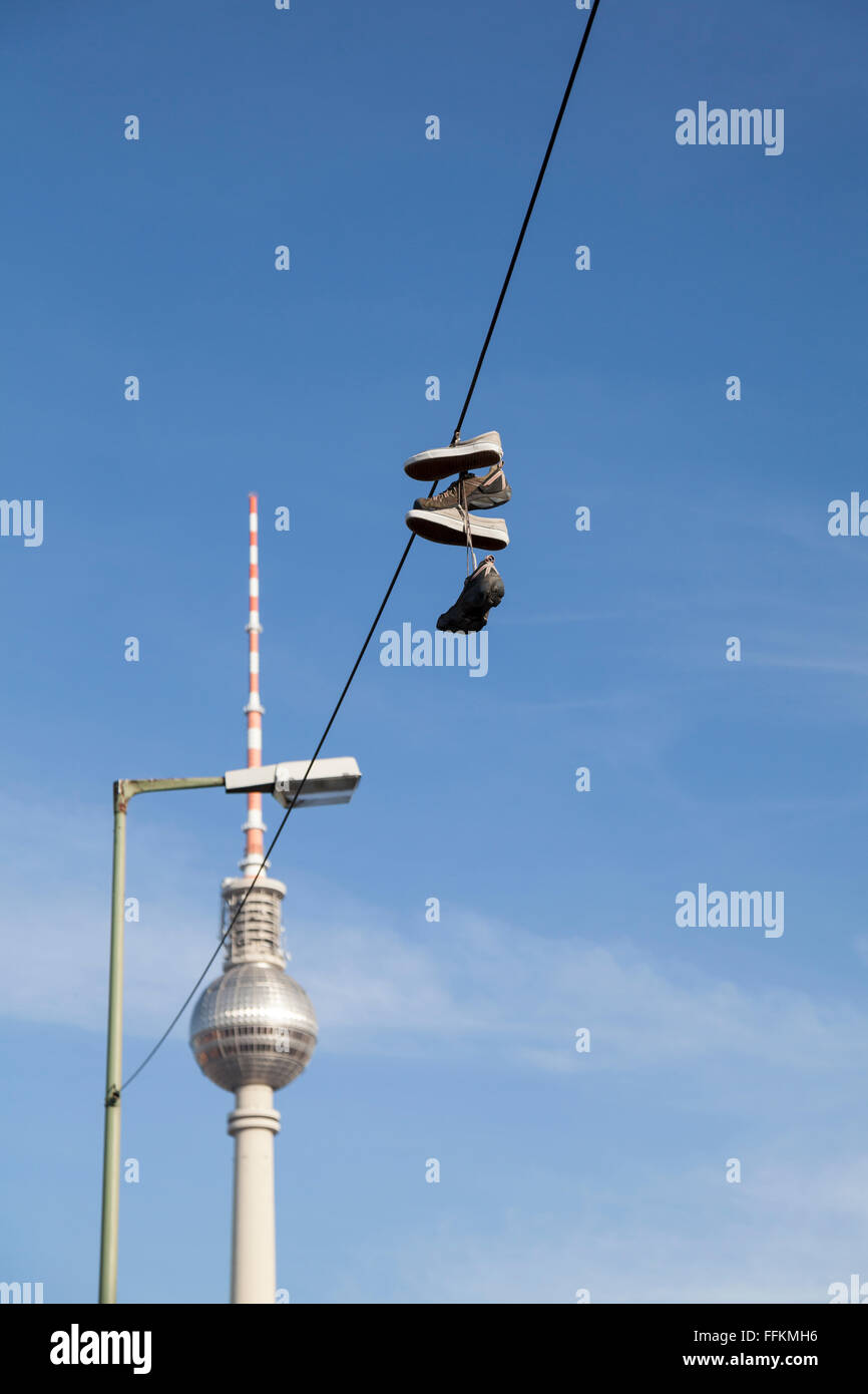 hanging shoes in berlin - Stock Image