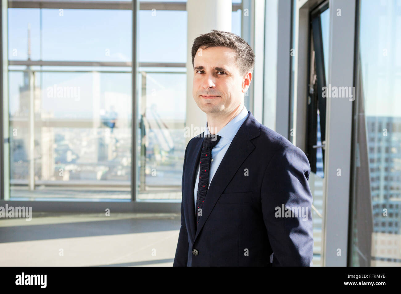 Portrait of well-dressed businessmen in modern office - Stock Image