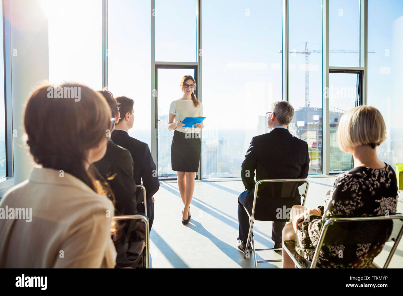 Businesswoman giving presentation in business meeting - Stock Image