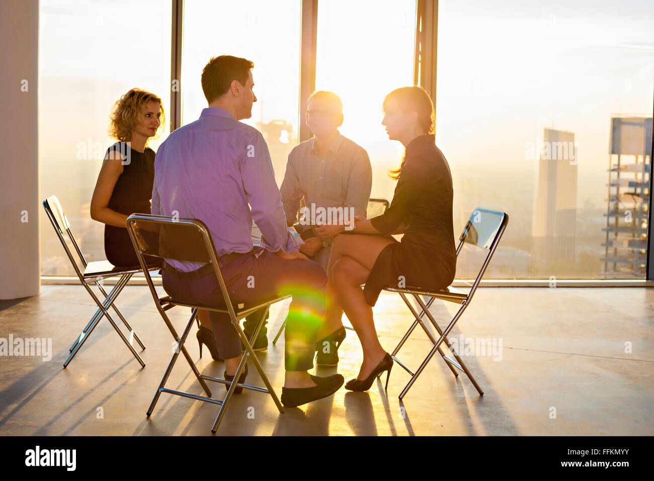 Architects and business people in business meeting - Stock Image