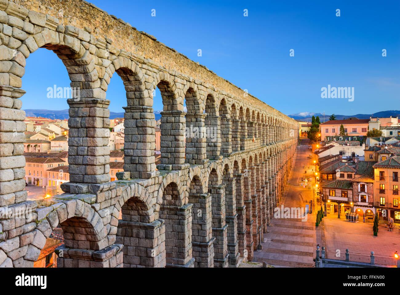 Segovia, Spain town view at Plaza del Azoguejo and the ancient Roman aqueduct. - Stock Image