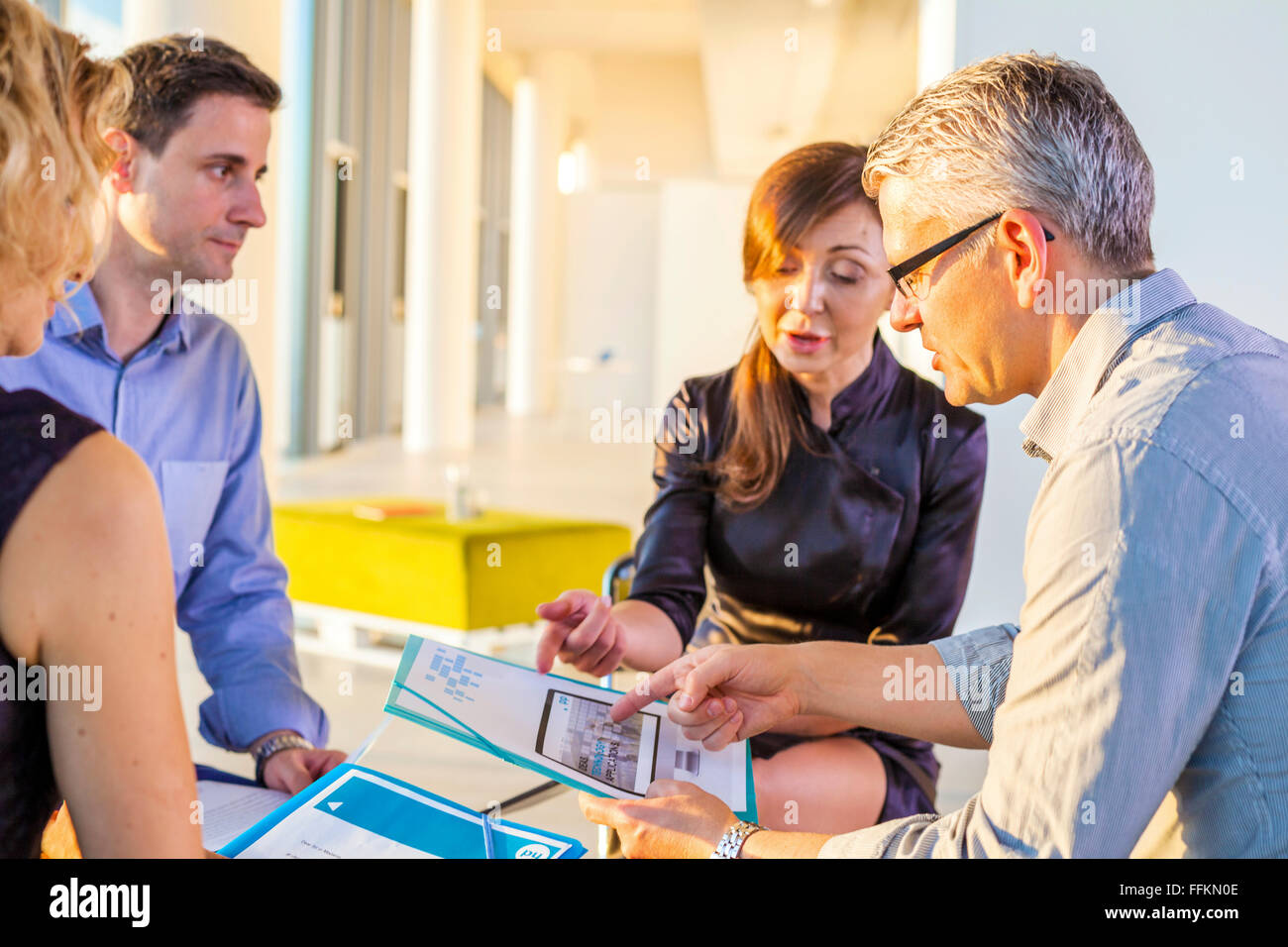 Meeting of architects and business people in modern office - Stock Image