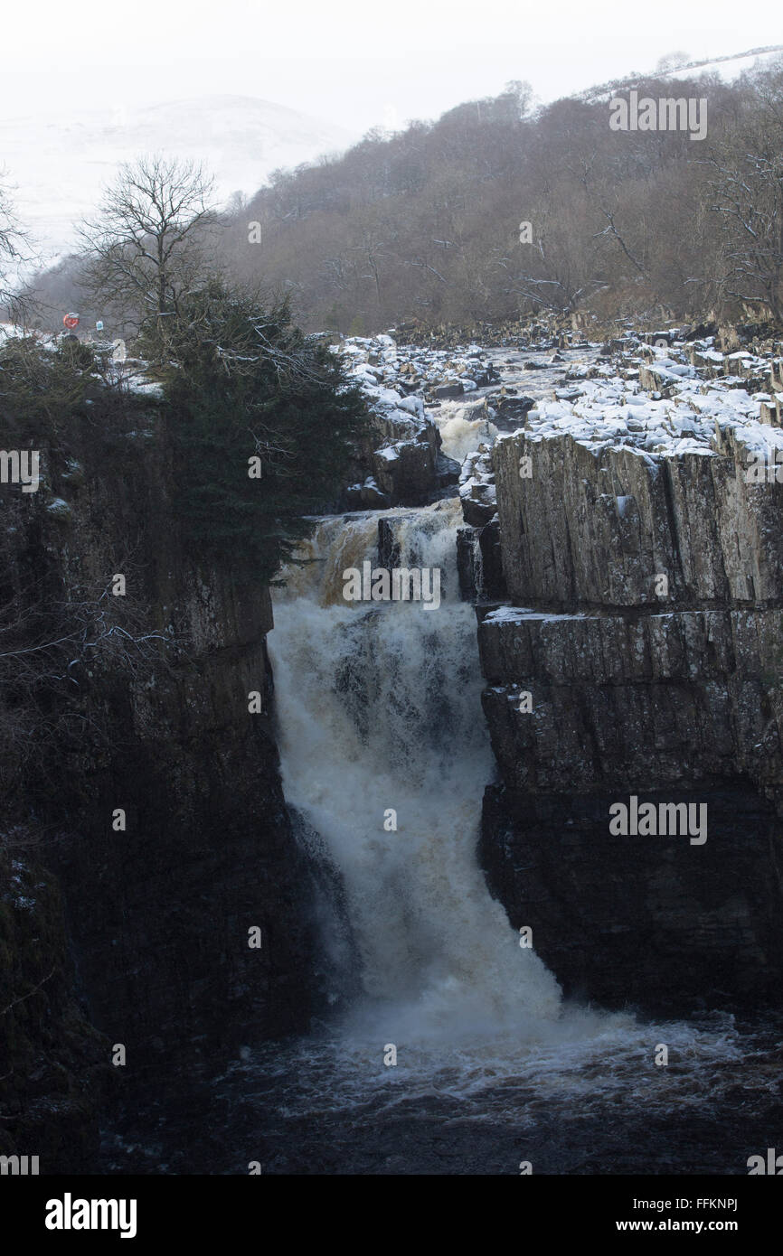 The River Tees tumbles over High Force at Upper Teesdale in County Durham, England. The water runs white. - Stock Image