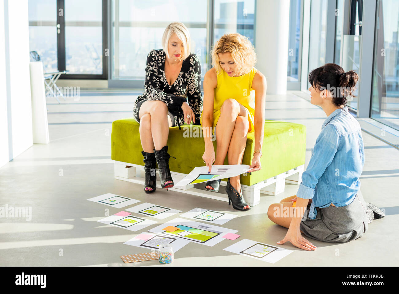 Three female architects in business meeting - Stock Image