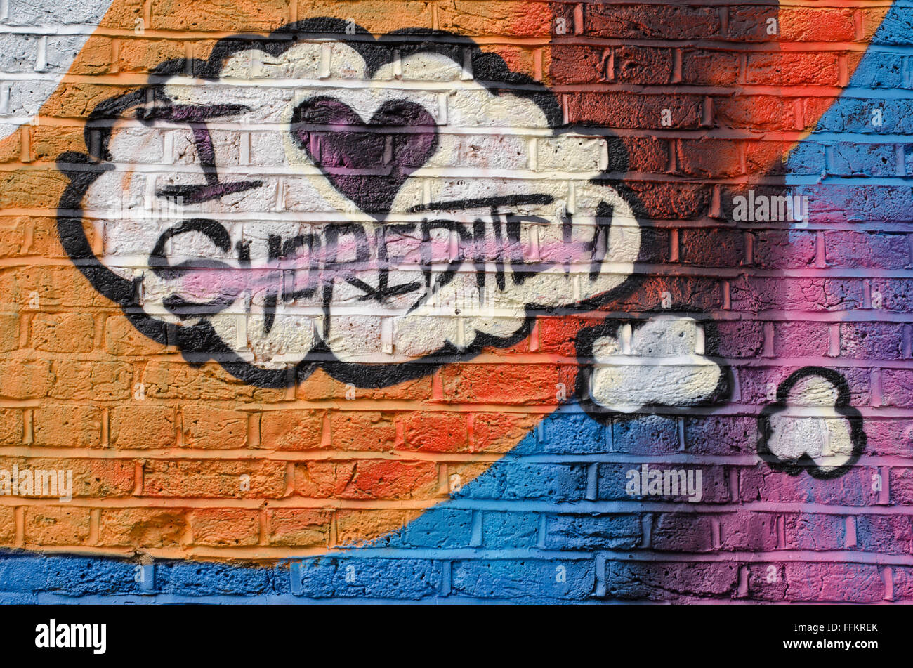 """Street art in London: comic balloon with the words """"I love Shoreditch"""" on a brick wall Stock Photo"""