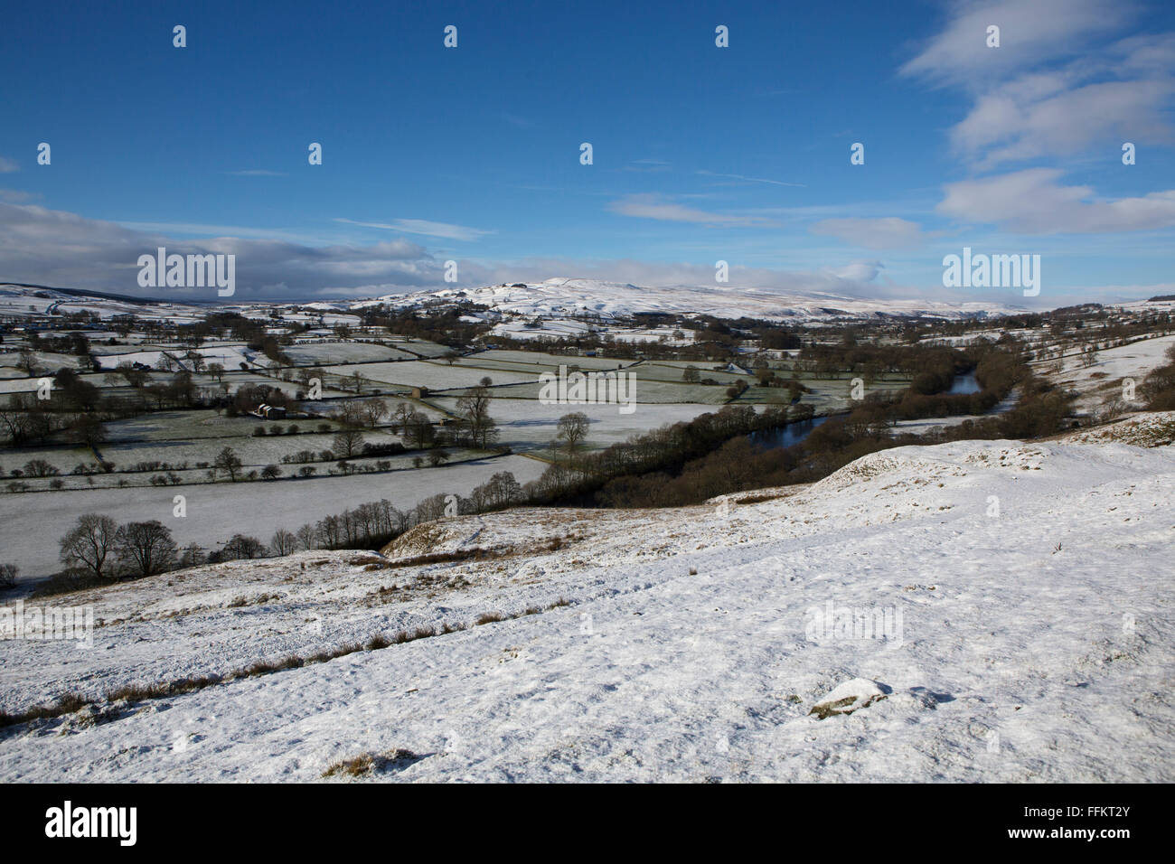 Snowy countryside at Upper Teesdale in County Durham, England. The River Tees runs through the frame. - Stock Image