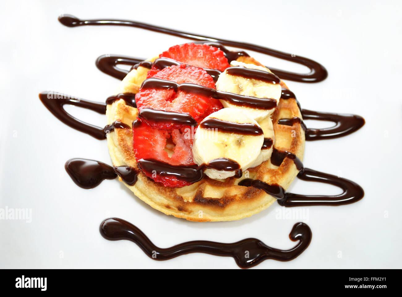 Gourmet Waffle Dessert with Fruit & Chocolate Sryup - Stock Image