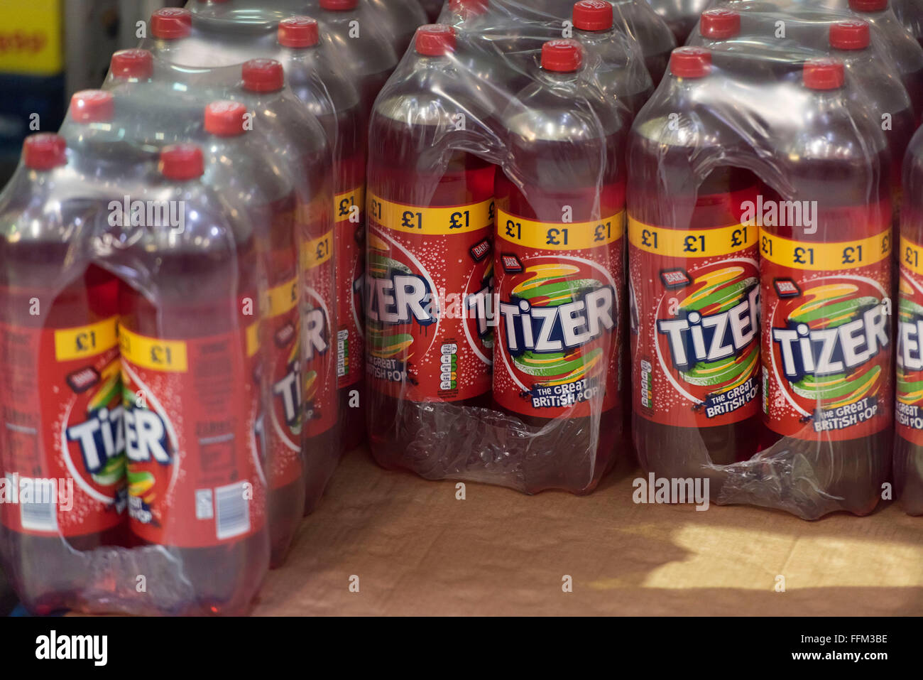 Bottles of sugar soft drink Tizer stocked in a warehouse. - Stock Image
