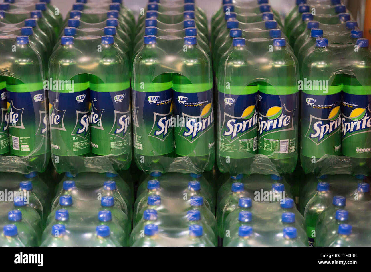 Bottles of sugar soft drink Sprite stocked in a warehouse. - Stock Image