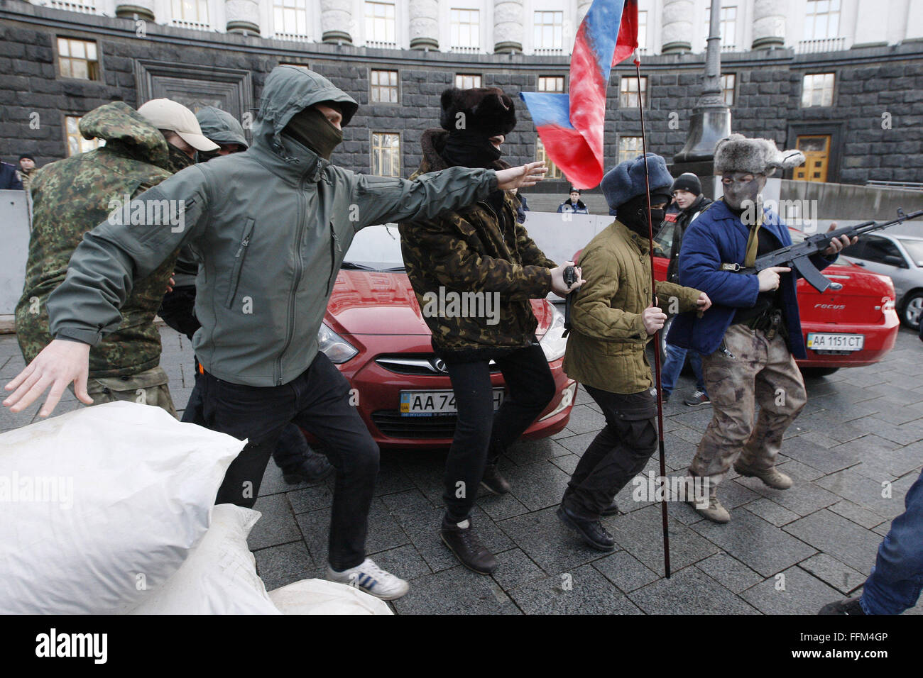Kiev, Ukraine. 15th Feb, 2016. Ukrainian activists in the similitude of pro-Russian separatists during the perfomance, - Stock Image