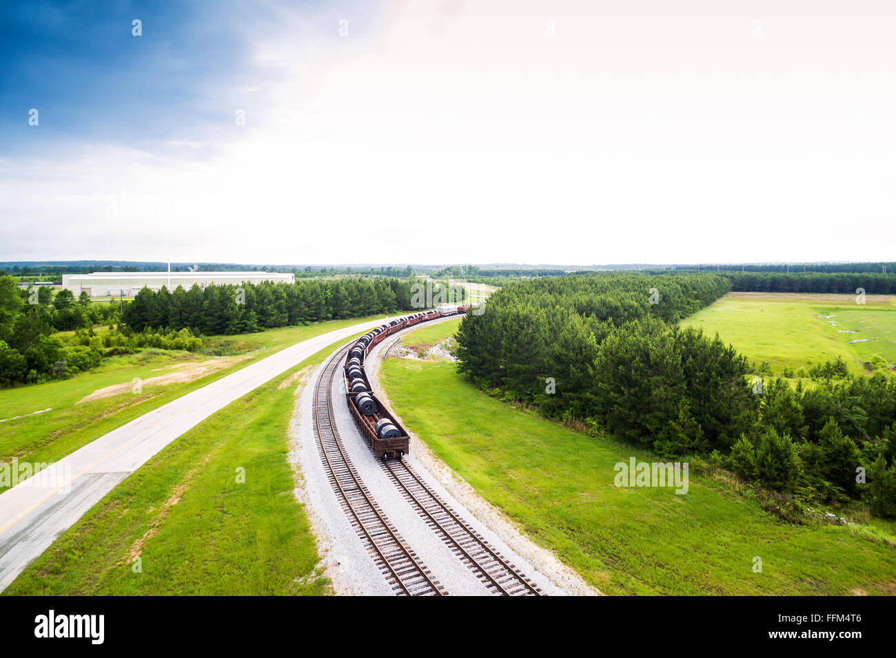 Aerial - steel coils in rail cars on train tracks in Alabama - Stock Image