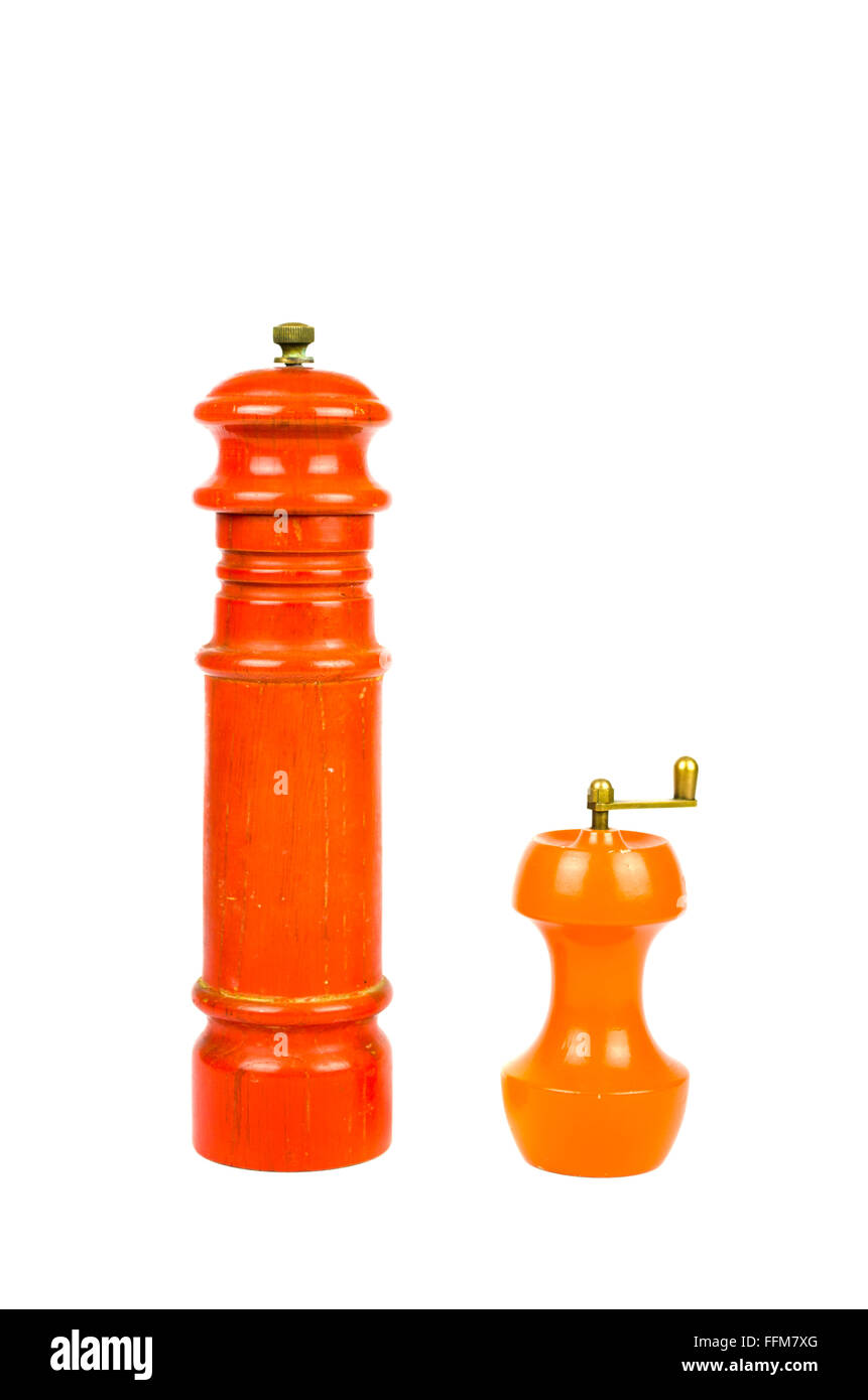 Two colorful manual wooden spice mills isolated on white - Stock Image