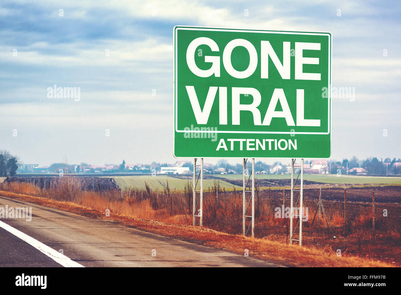 Gone viral concept with road sign, retro toned. - Stock Image