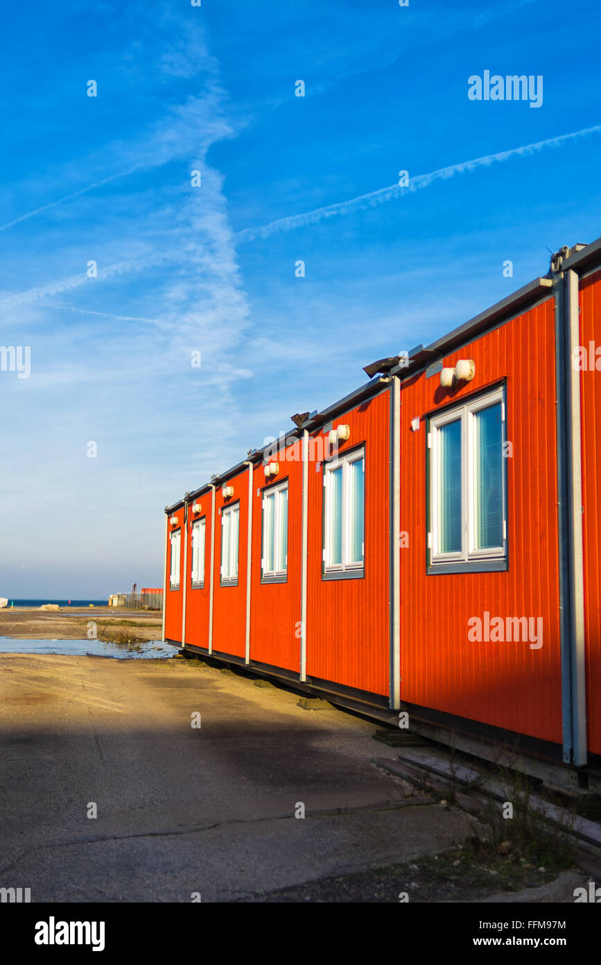 Conventional shipping containers housing on a bright sunny day - Stock Image