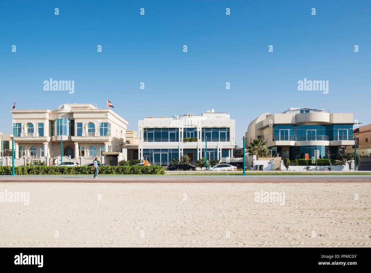 Luxury villas facing onto beach in Dubai United Arab Emirates - Stock Image