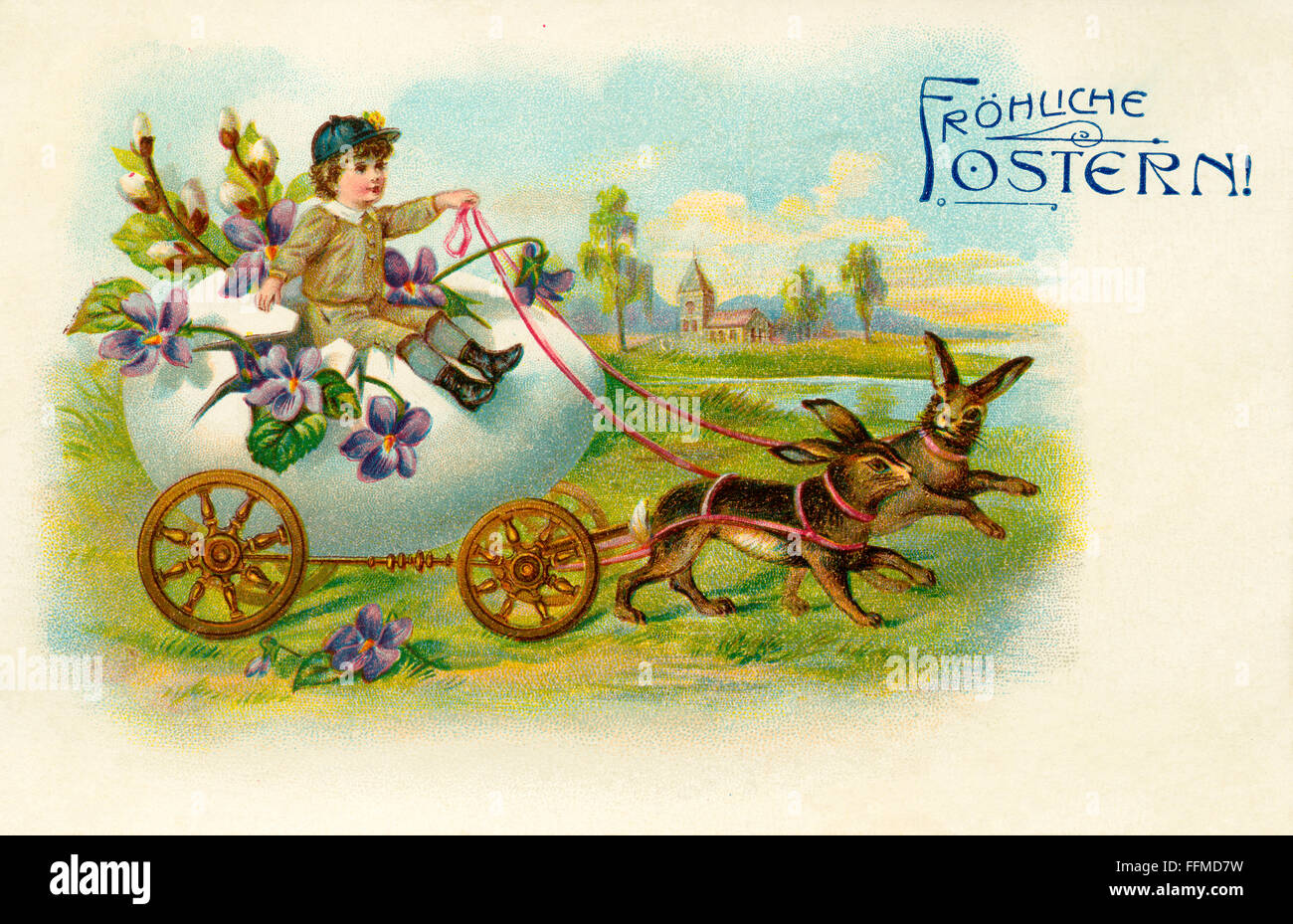 """Easter card sent 1909, with the text """"Happy Easter"""", a little boy on an egg with wheels, pull by hares, Germany, Stock Photo"""
