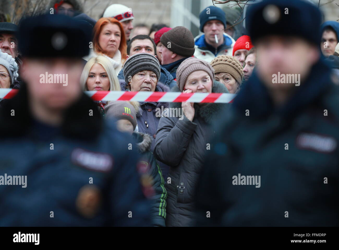 Yaroslavl, Russia. 16th February, 2016. Local residents outside the sealed off area around the site of a blast in - Stock Image