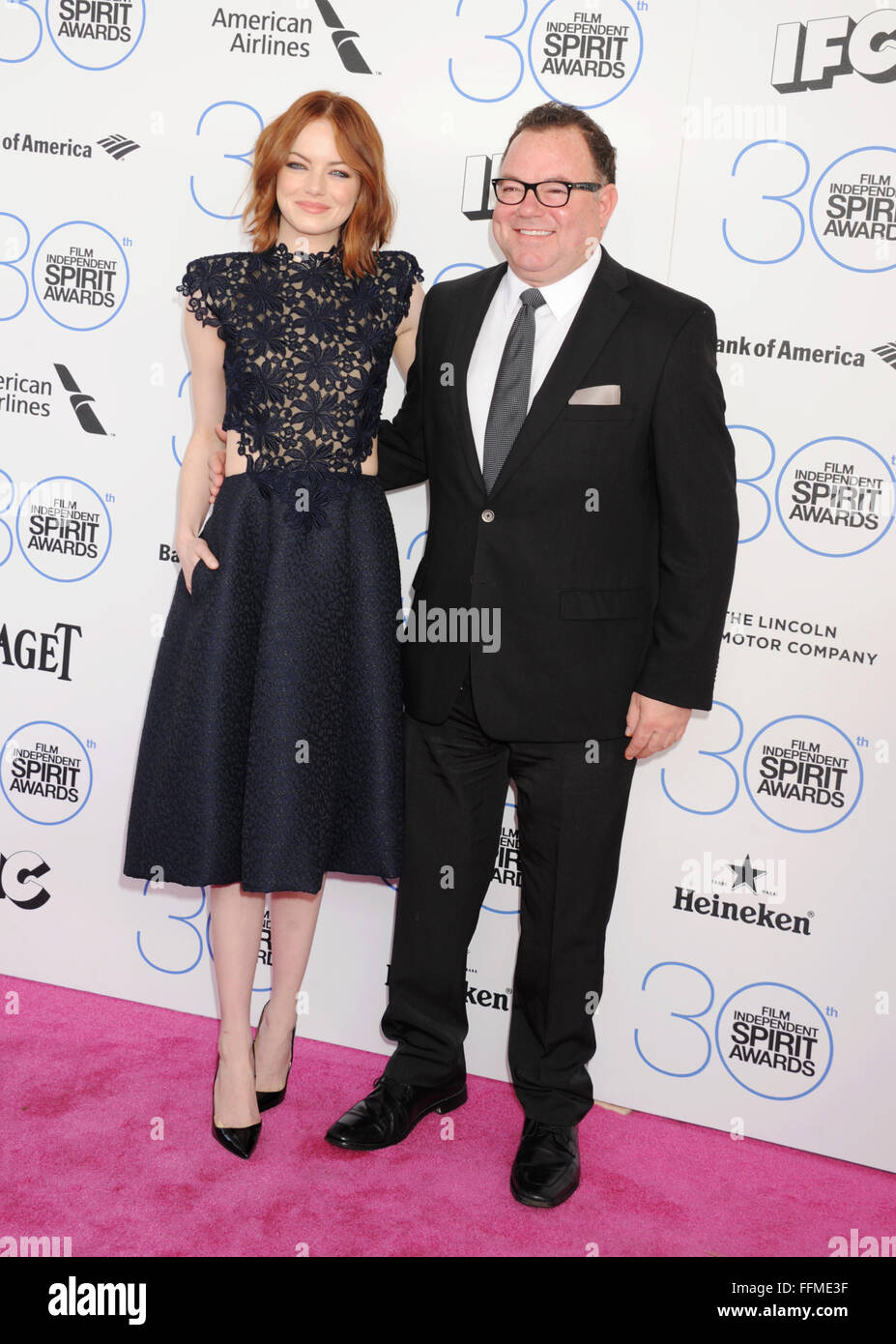 Actress Emma Stone (L) and father Jeff Stone arrive at the 2015 Film Independent Spirit Awards on February 21, 2015 - Stock Image
