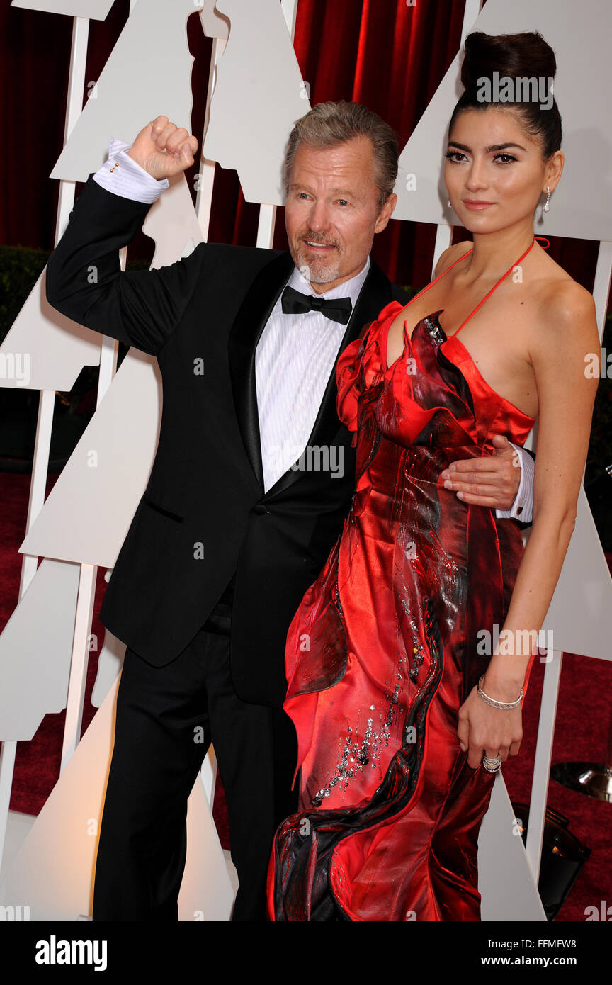Actors John Savage (L) and Blanca Blanco arrive at the 87th Annual Academy Awards at Hollywood & Highland Center - Stock Image