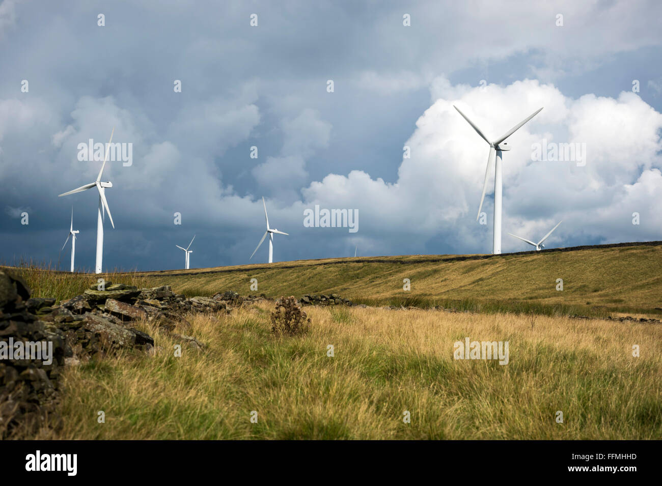 wind turbine and clouds - Stock Image