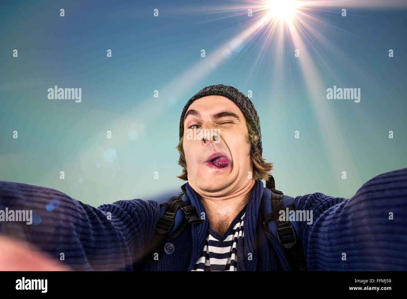 Composite image of hipster holding camera and grimacing - Stock Image