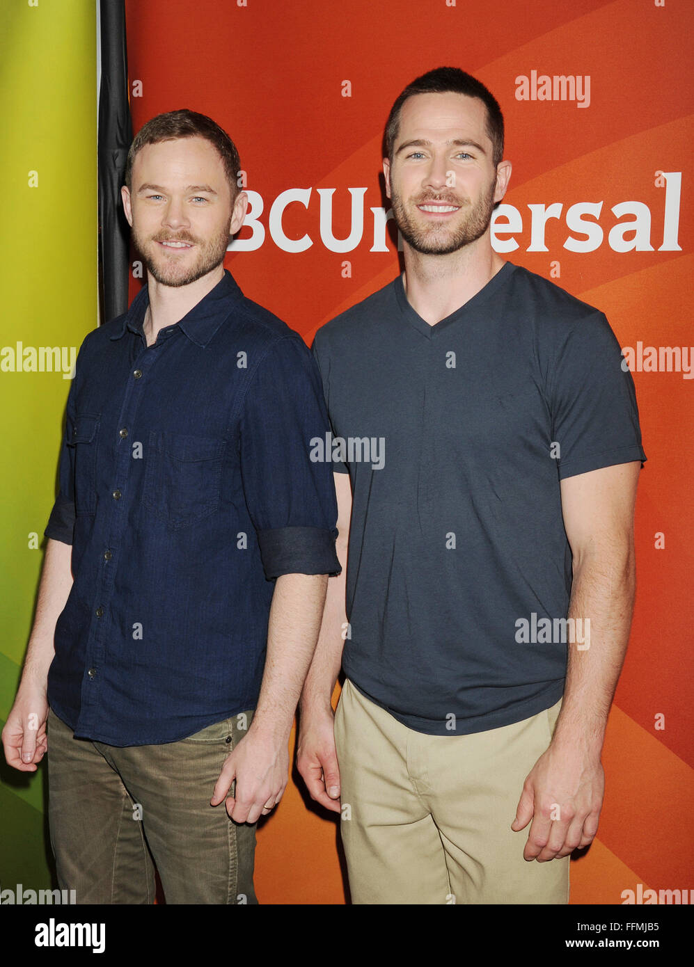 Actors Aaron Ashmore (L) and Luke MacFarlane attend the 2015 NBCUniversal Summer Press Day held at the The Langham - Stock Image