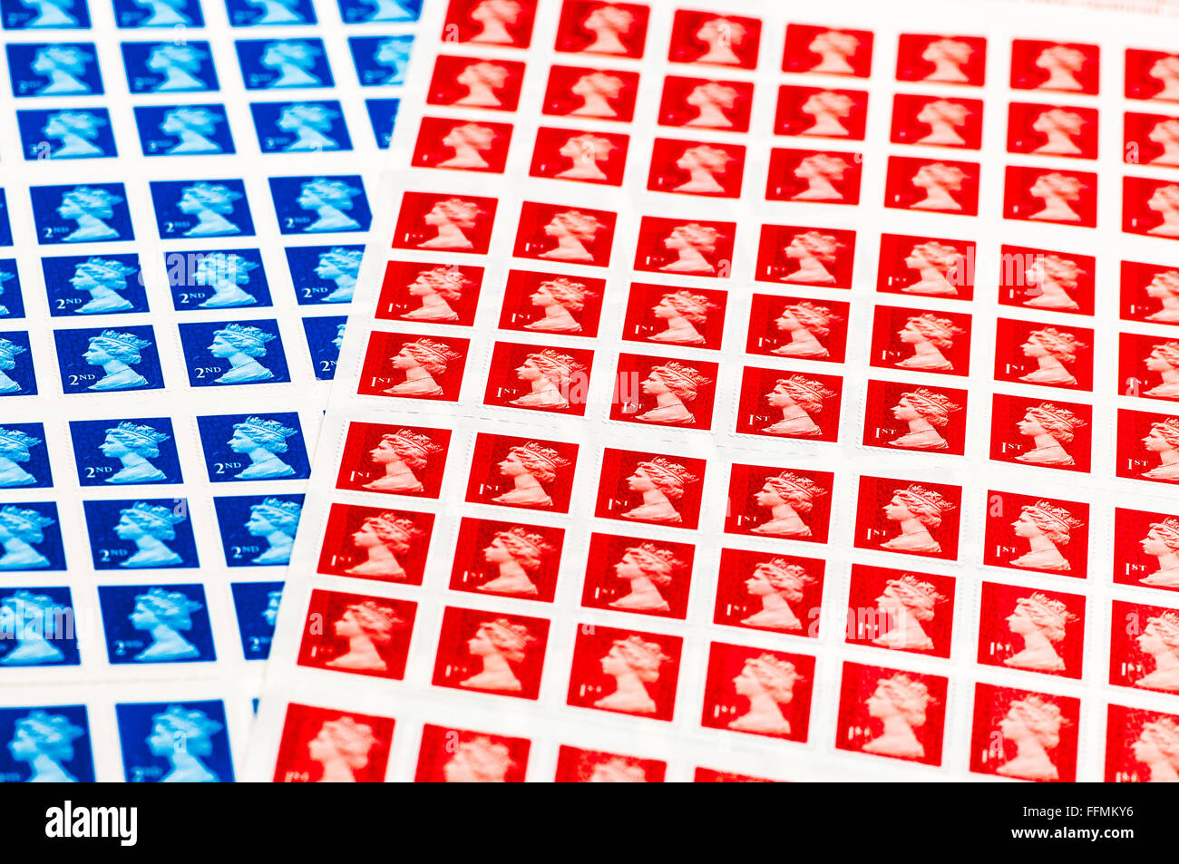 Sheets of UK 1st and 2nd class stamps. - Stock Image