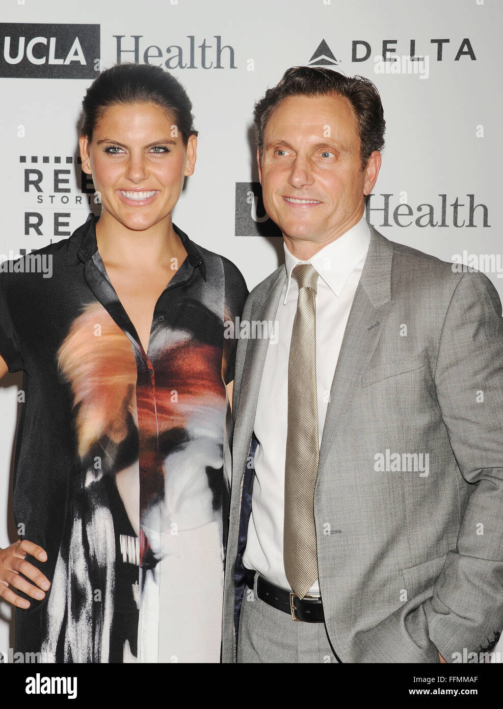 Actor Tony Goldwyn (R) and his daughter Anna Goldwyn arrive at the 4th Annual Reel Stories, Real Lives event benefiting - Stock Image