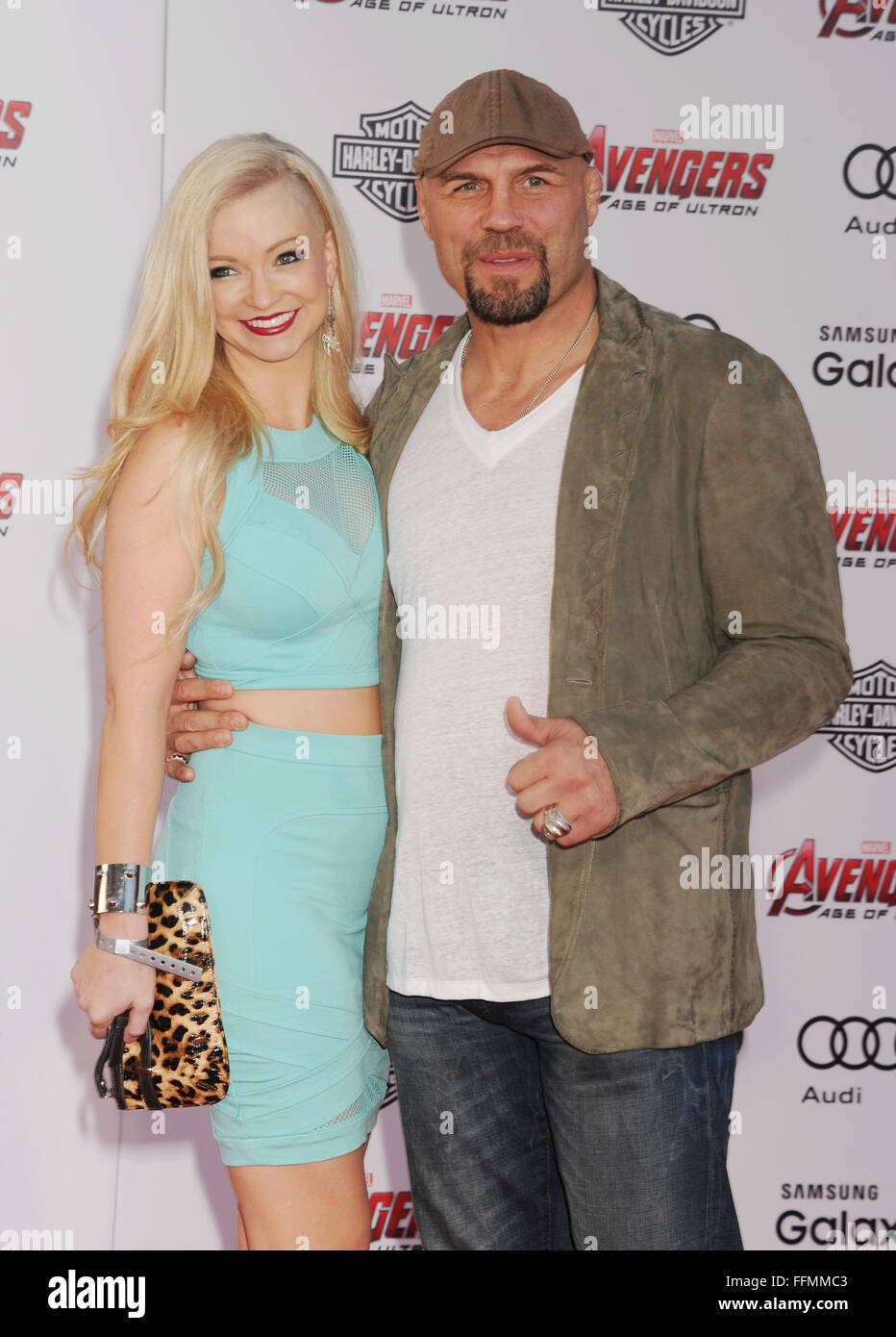 """Actress Mindy Robinson (L) and former mixed martial artist and actor Randy Couture arrive at the Marvel's """"Avengers: Stock Photo"""