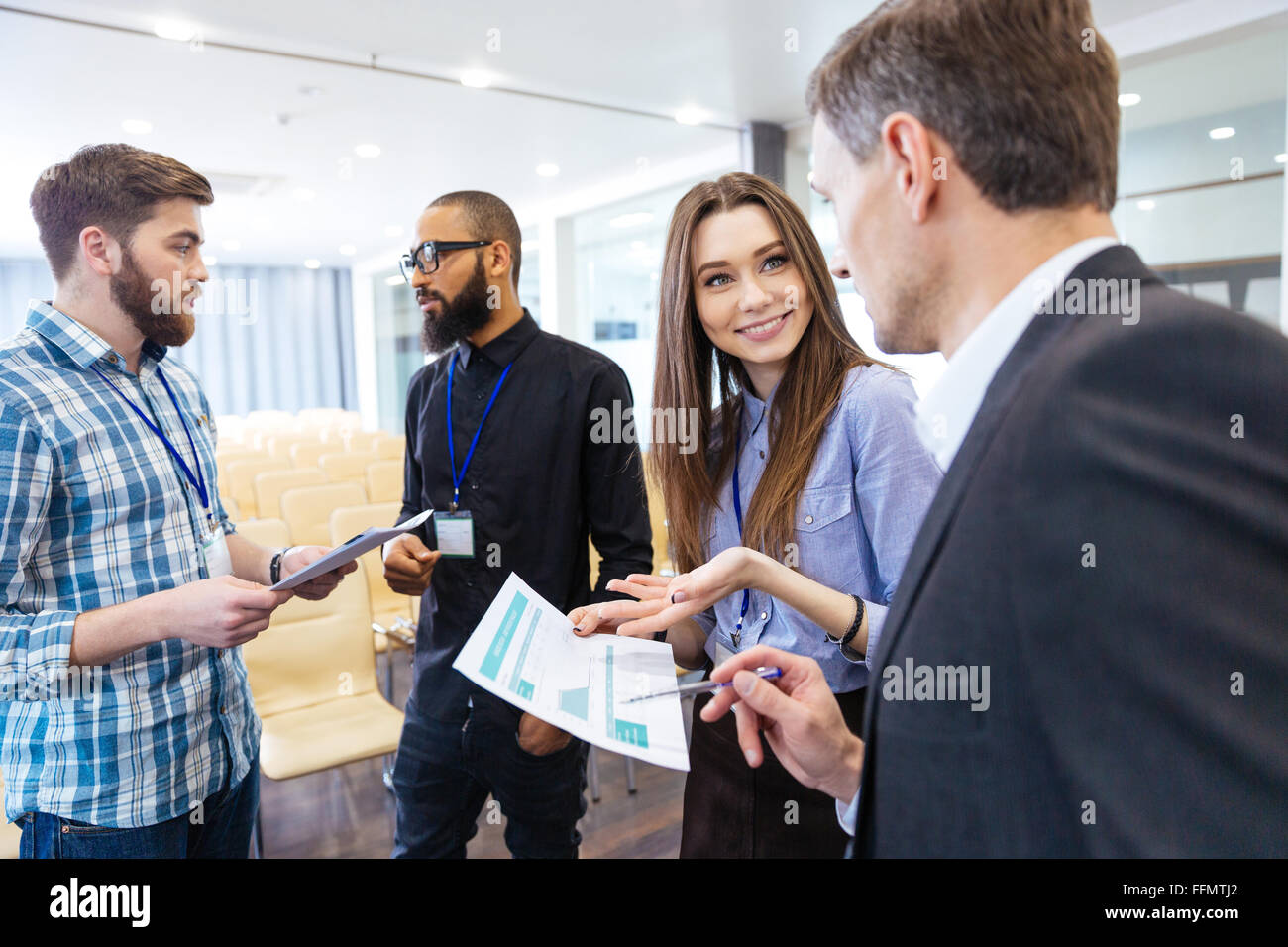 Group of young business people discussing financial report and  new project in conference hall Stock Photo