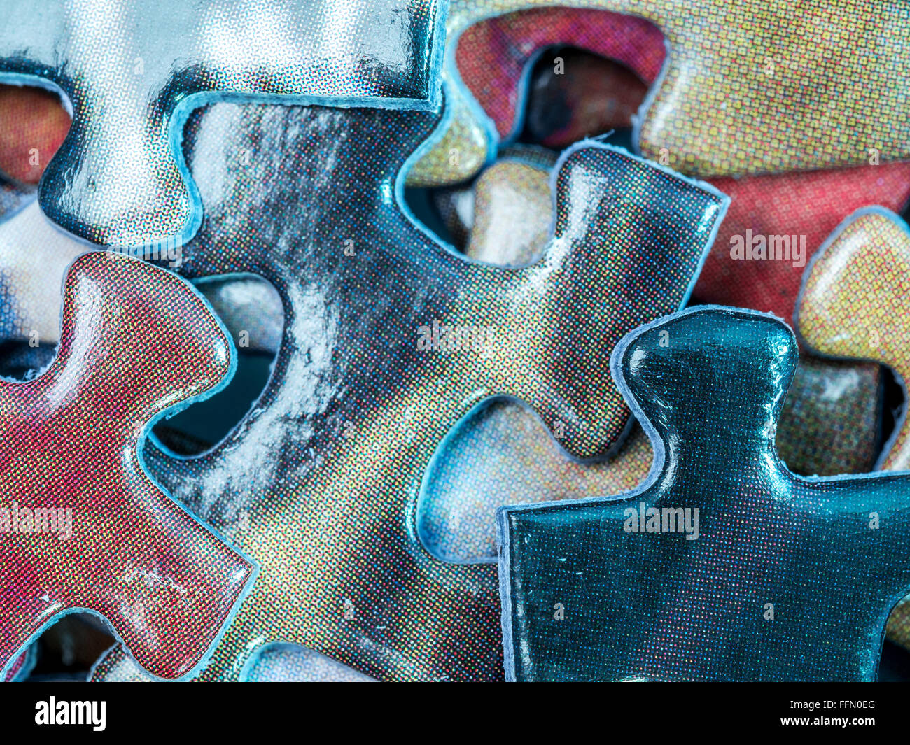 Background of scattered colorful puzzle pieces - Stock Image
