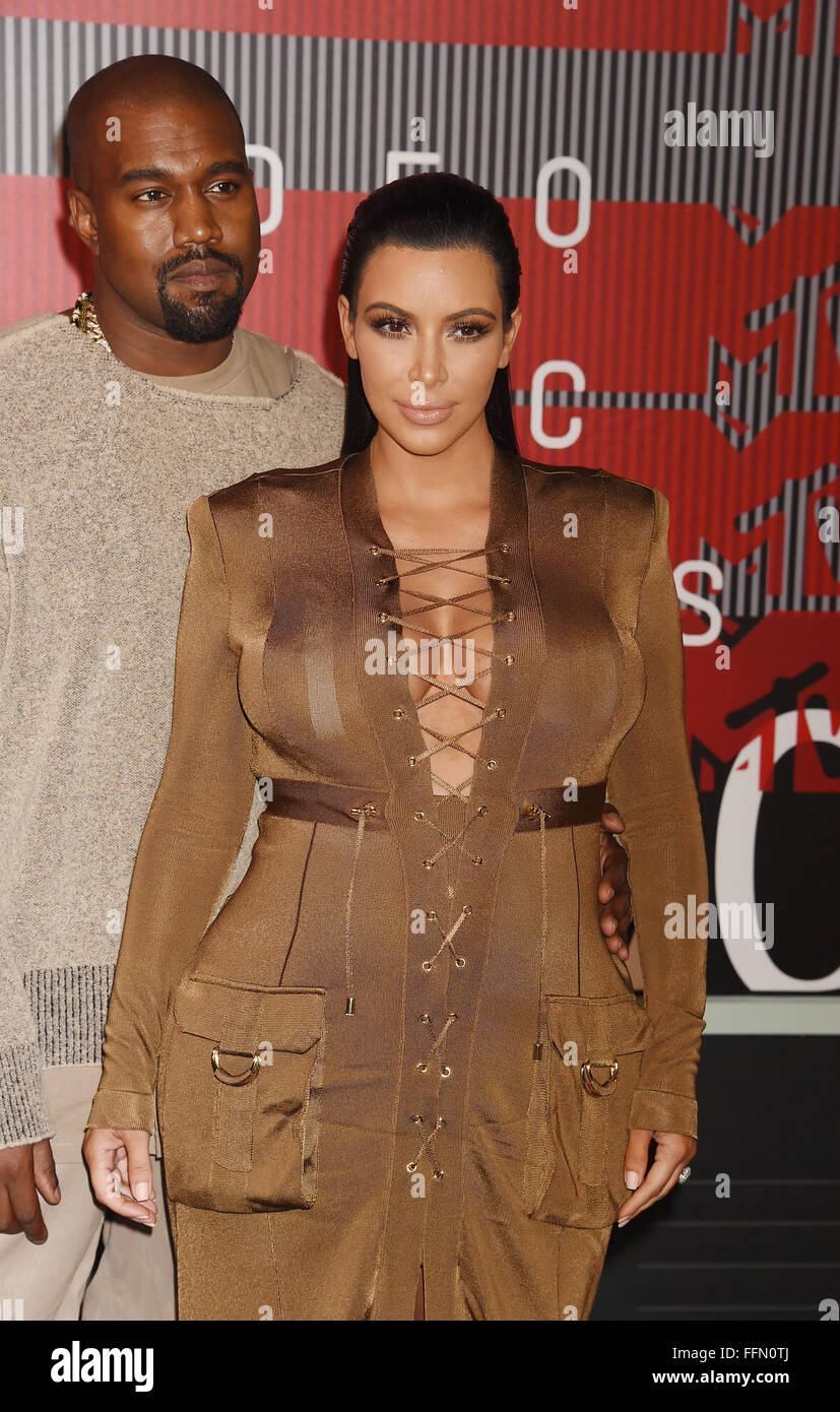 Rapper Kanye West and TV personality Kim Kardashian arrive at the 2015 MTV Video Music Awards at Microsoft Theater - Stock Image
