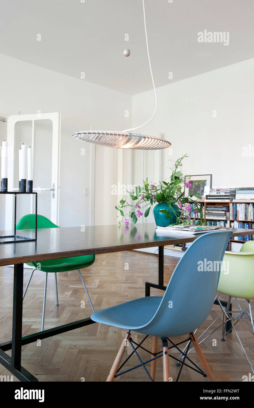 Modernism in the 'Cake House'. A dining table with small chairs. - Stock Image