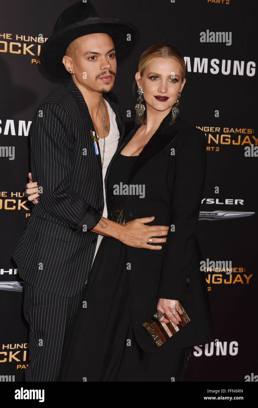 Actor Evan Ross (L) and wife, singer Ashlee Simpson arrive at the premiere of Lionsgate's 'The Hunger Games: - Stock Image