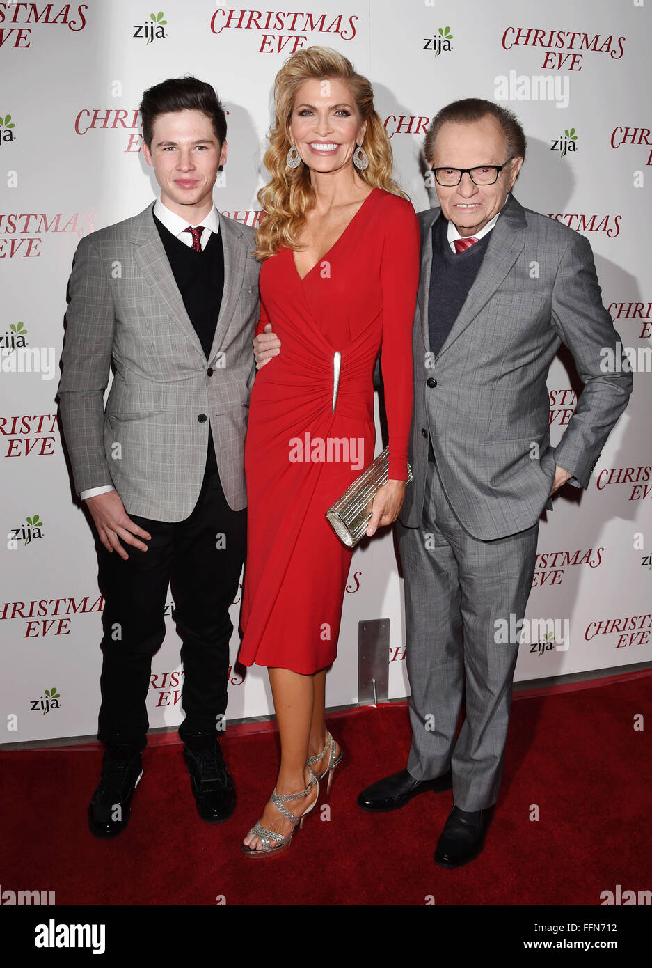 (L-R) Cannon King, producers/parents Shawn King and Larry King arrive at the premiere of Unstuck's 'Christmas - Stock Image