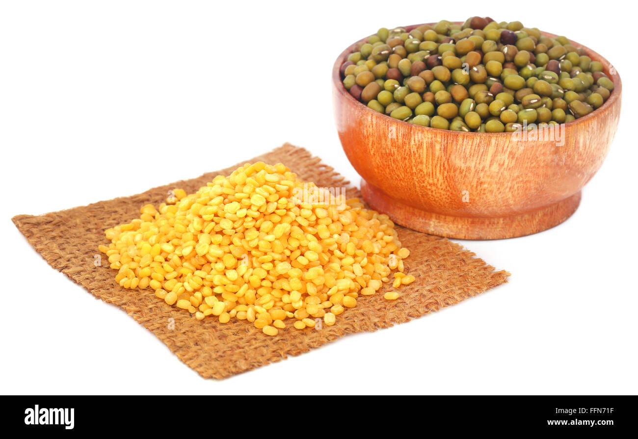 Mung bean in jute bag and bowl over white background - Stock Image