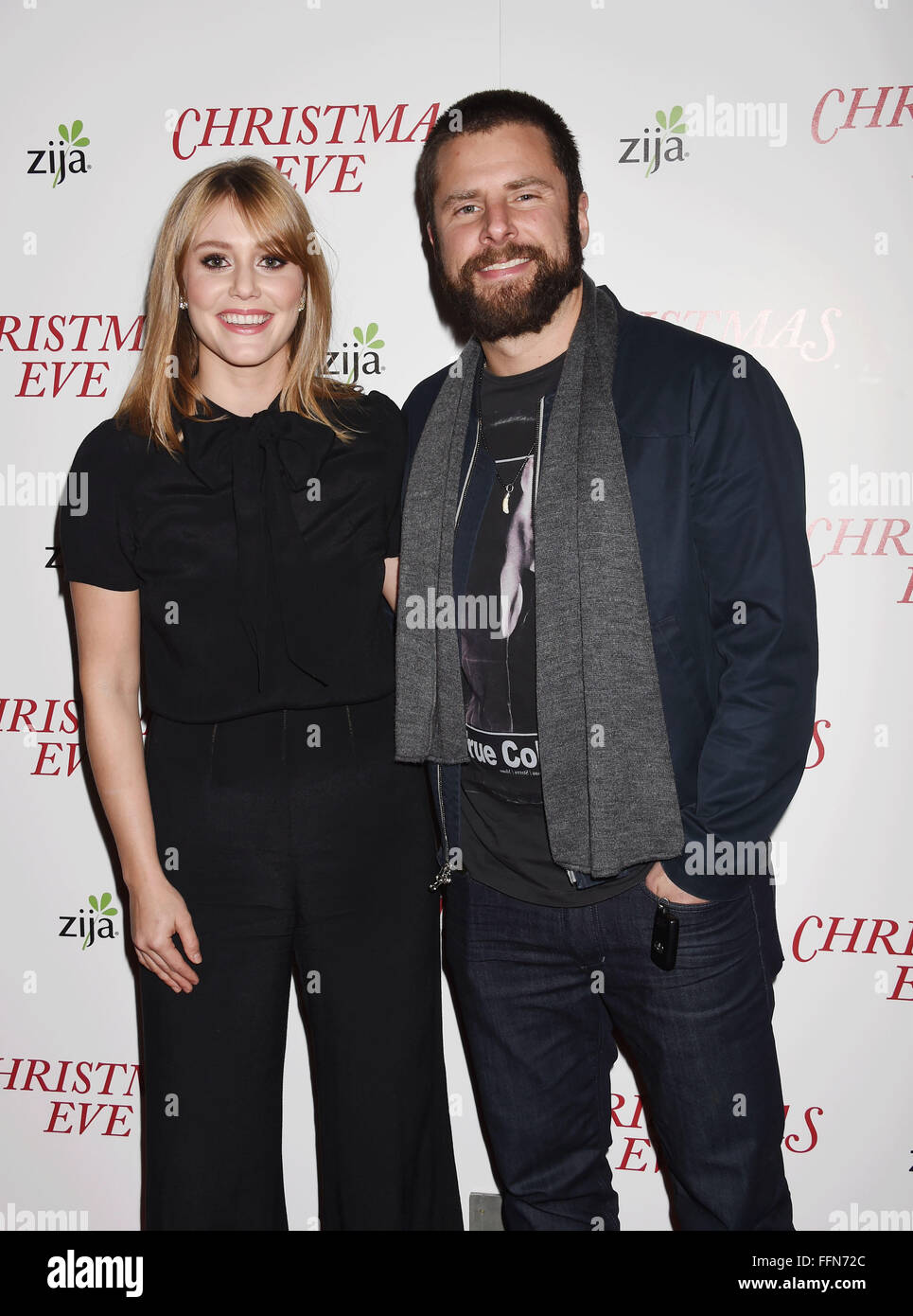 Actors Julianna Guill (L) and James Roday arrive at the premiere of Unstuck's 'Christmas Eve' at the - Stock Image