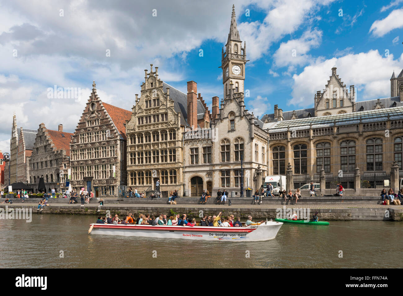 Ghent, Belgium - Sightseeing boat full of tourists on a trip on the river Leie in beautiful city of Ghent, Belgium, - Stock Image