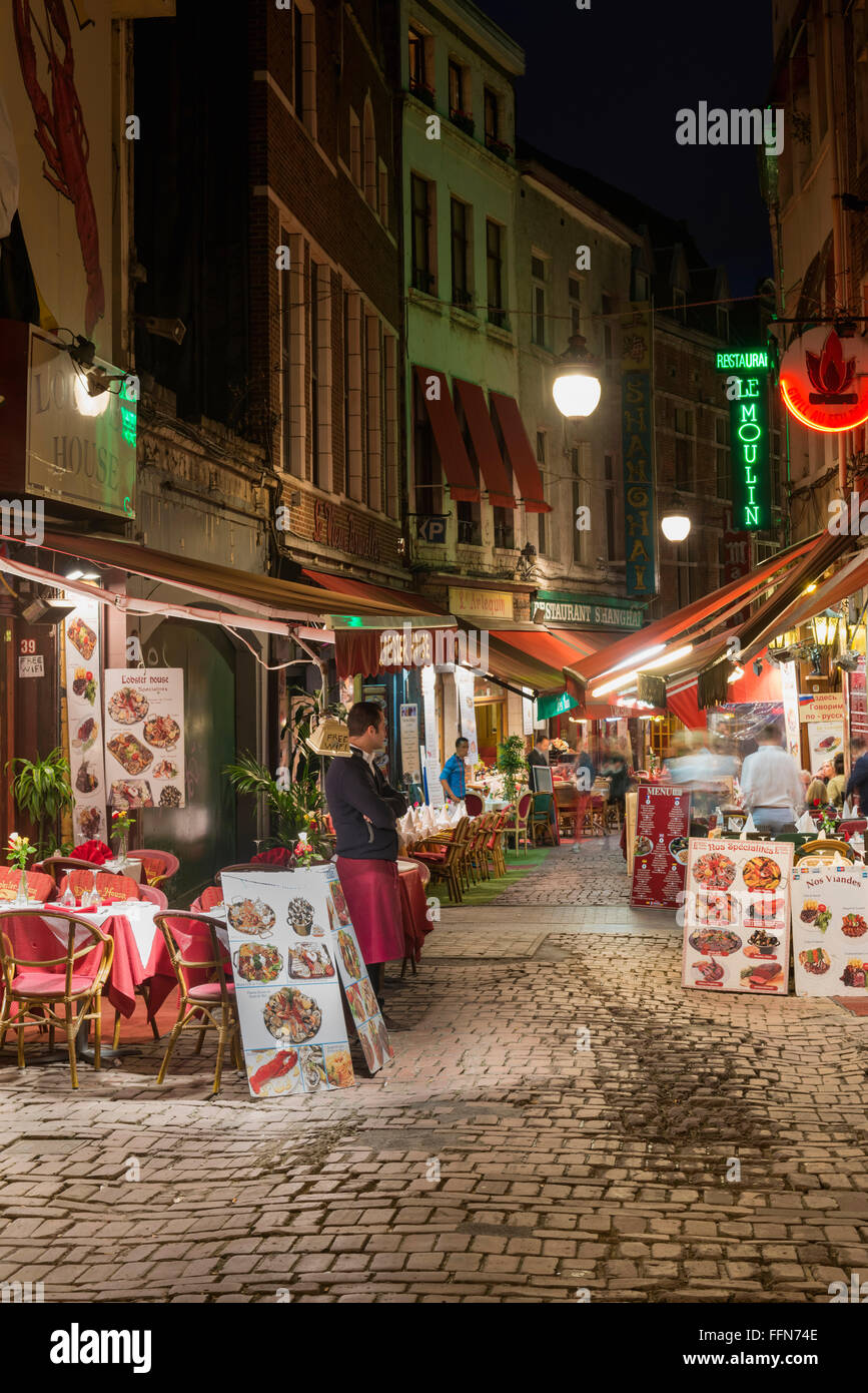 Belgium, Brussels - Rue des Bouchers, restaurants line the streets in Brussels city, Belgium, Europe at night - Stock Image