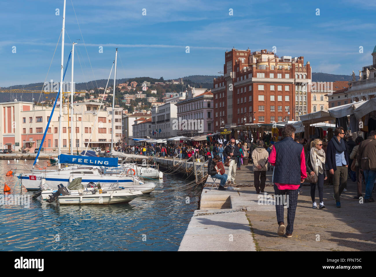 Trieste waterfront with market stalls, Trieste, Italy, Europe - Stock Image
