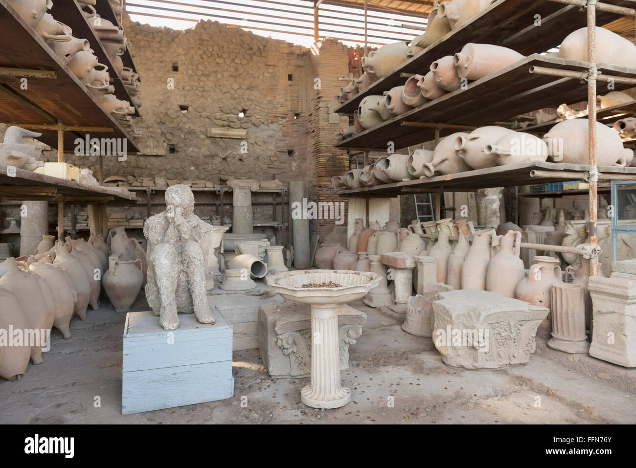 Earthenware pots and the cast of a person recovered from the ruins in Pompeii, Italy, Europe - Stock Image