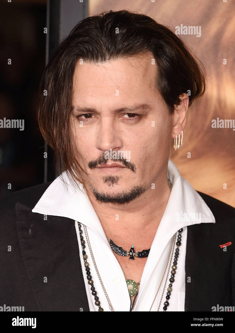 "Actor Johnny Depp arrives at the premiere of Focus Features' ""The Danish Girl"" at Westwood Village Theatre on November Stock Photo"