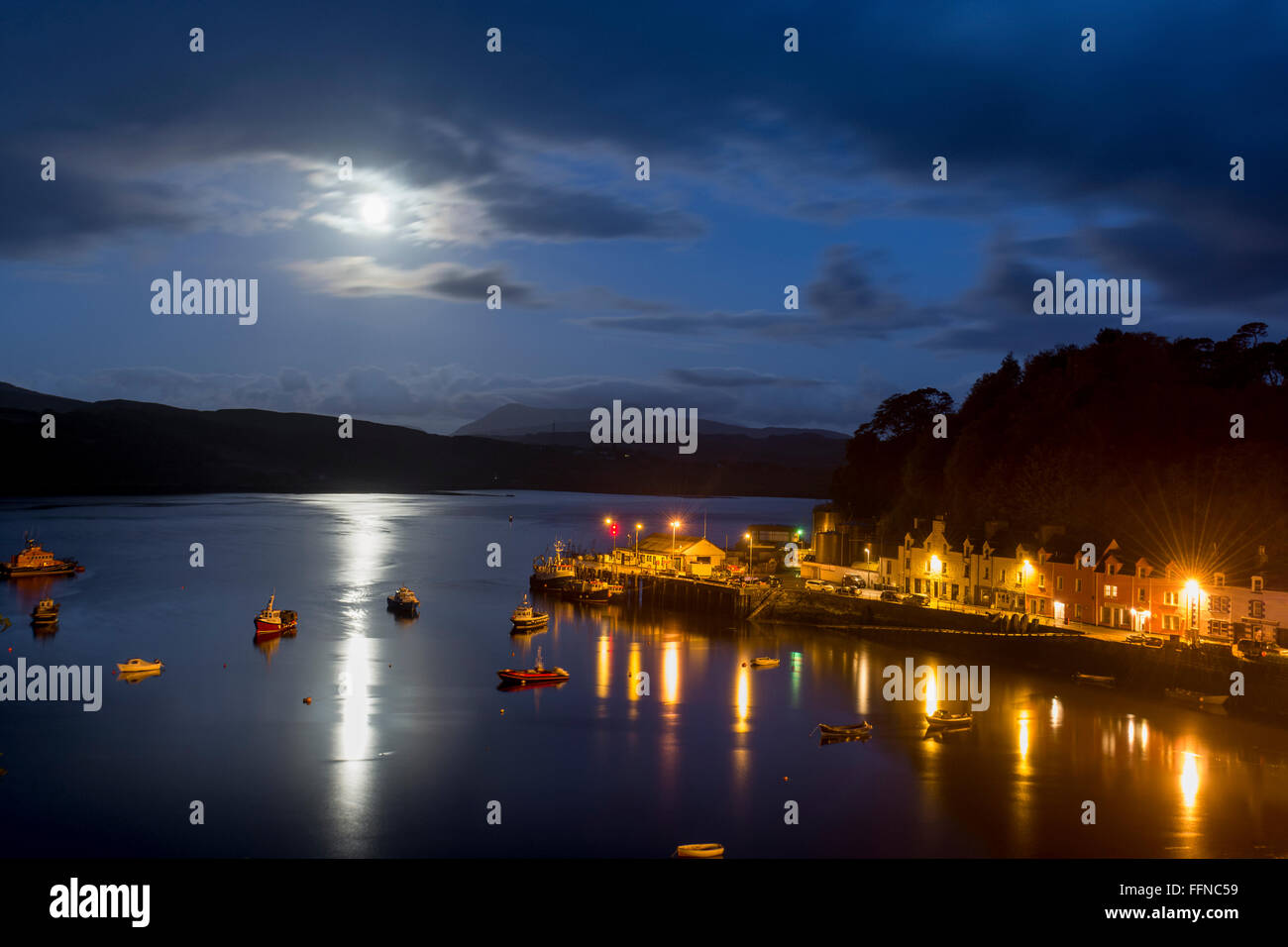 portree harbour in moonlight with harbour lights - romantic & peaceful - Stock Image