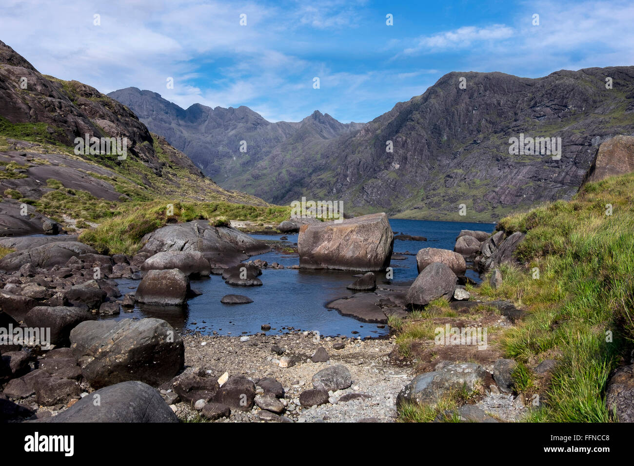 loch coruisk and mountain in cuillins with reflections & jagged skyline - Stock Image