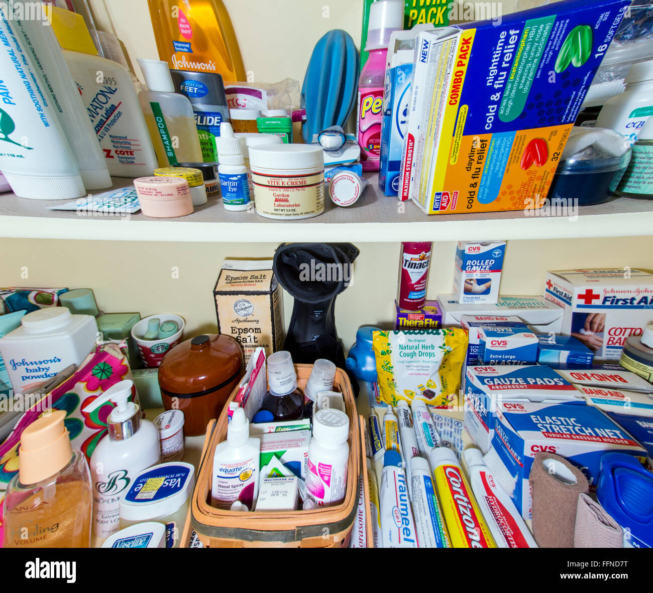 Wide angle view of home medicine cabinet shelves full of pharmaceuticals, drugs, balms, bandages, ointments and - Stock Image
